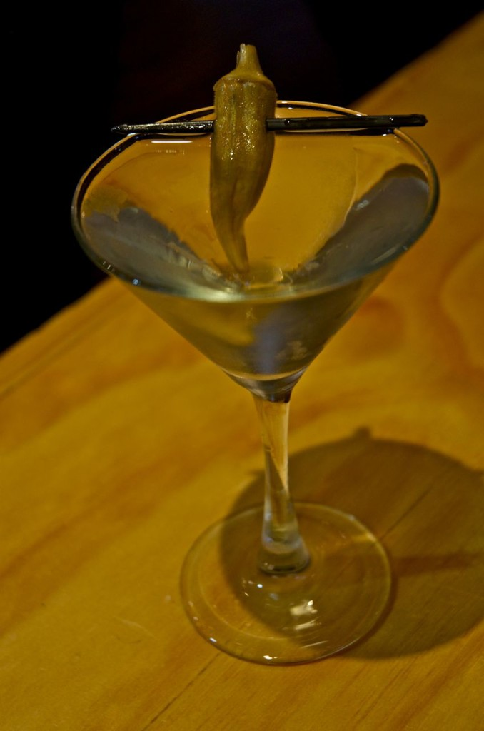 martini with a pickled okra