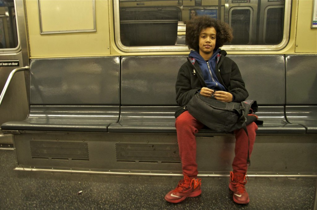 boy-with-red-sneakers-on-subway